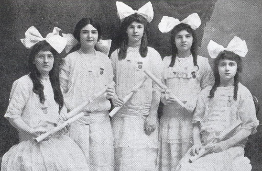 five women in dresses