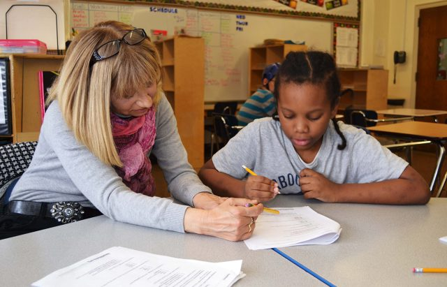 Teacher reviewing an assignment with a student.