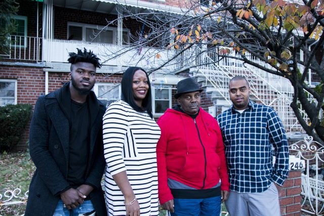 Direct Support Professional Yusuf Atanda, Residence Coordinator Keisha Briggs, Ralph Avenue resident Peter and Program Coordinator Pedro Vargas outside the HeartShare group home.