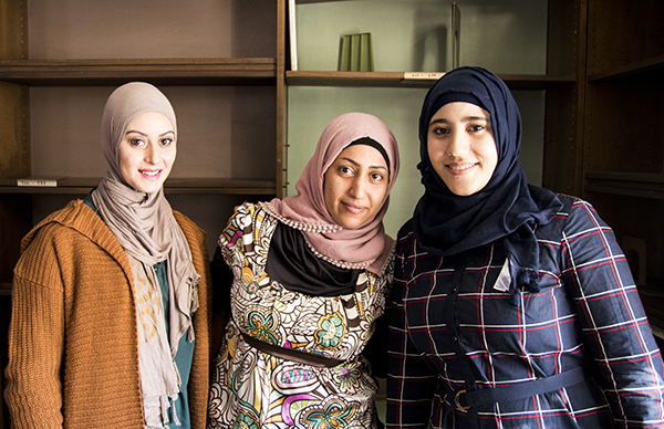 Arabic women with instructor in conversational English class